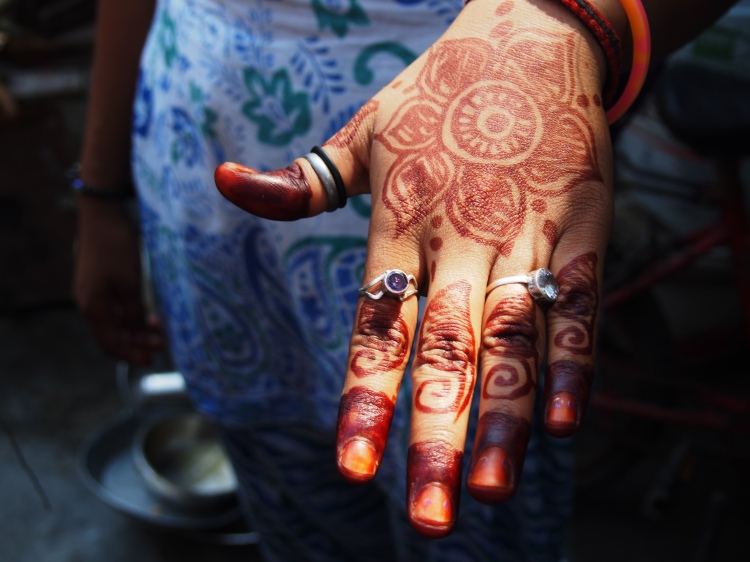 Girls and women use their skills in Henna to trade.