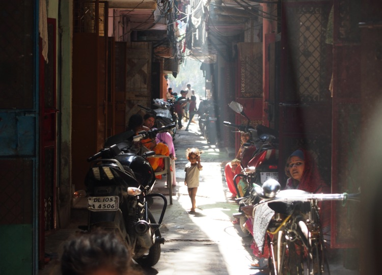 A child stands in the slums of Kathputli Colony.