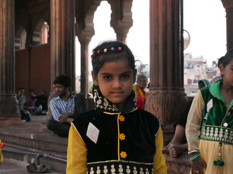 Children are dressed up by their parents and offered up for photos with tourists. The parents then often ask for money in return.