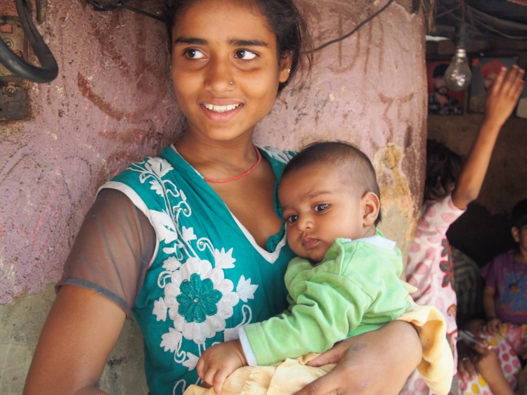 Vaisha is a teenage mother and looks after a group of children in he area in the slums.