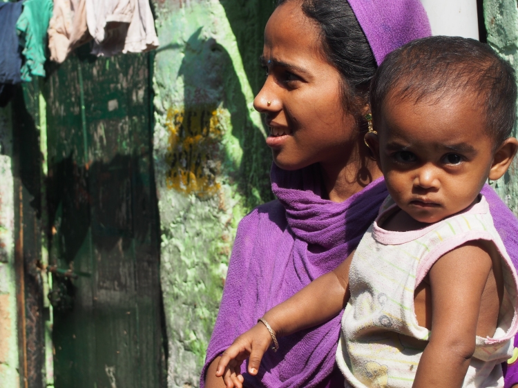 It is a common sight to see a young mother and her child in the slums.